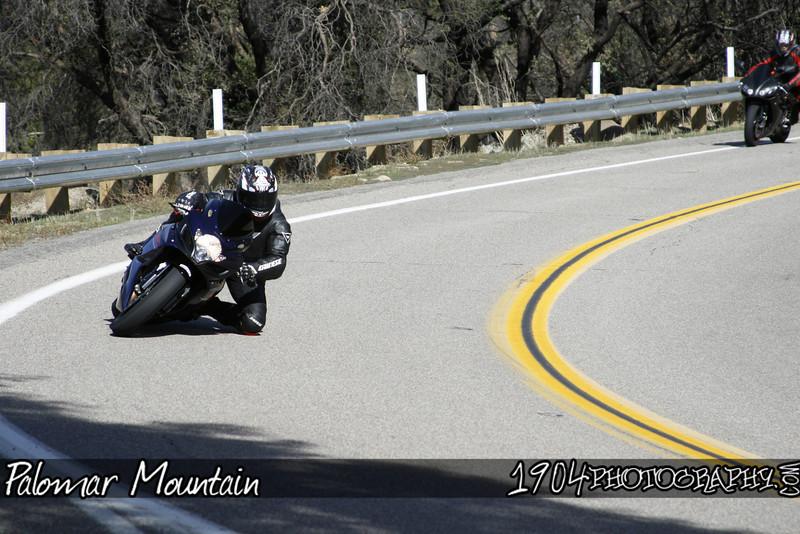 A suzuki GSX-R heads down Palomar mountain on south grade road.