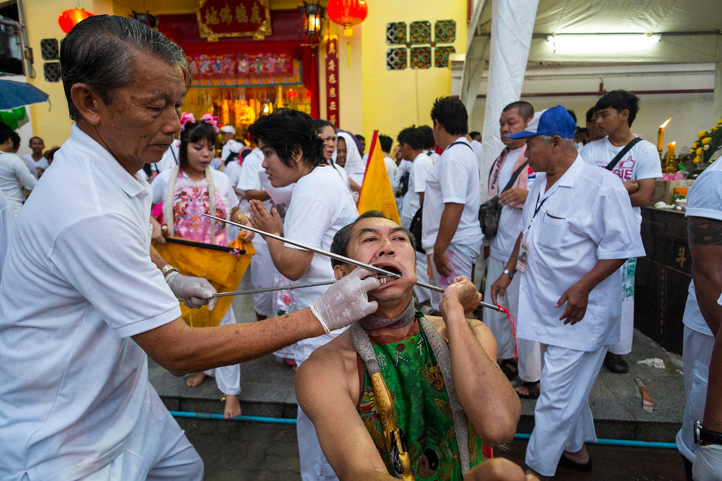 . A devotee has his face pierced with steel rods outside Jui Tui Chinese Shrine on September 30, 2014 in Phuket, Thailand. (Photo by David Longstreath/Getty Images)