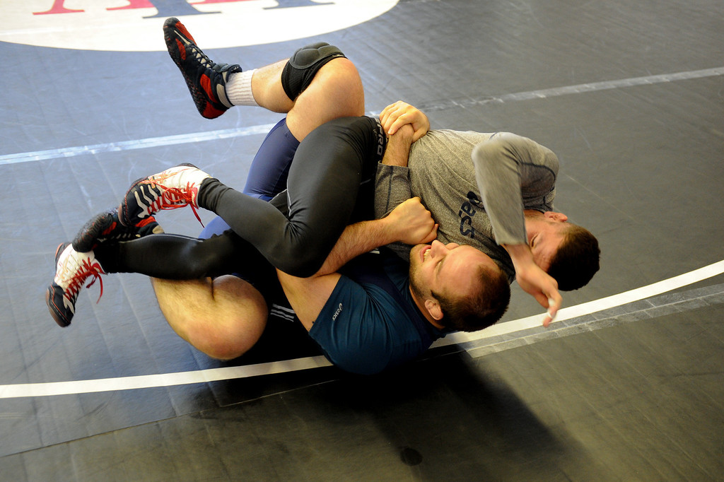 . The U.S. national wrestling team members Tervel Dlagnev, left, and Jon Reader practice at Harvard-Westlake High School, Friday, May 17, 2013. The USA, Canada and Russia national teams will meet for in exhibition 2:00 p.m. Sunday at L.A. Memorial Sports Arena. (Michael Owen Baker/Staff Photographer)