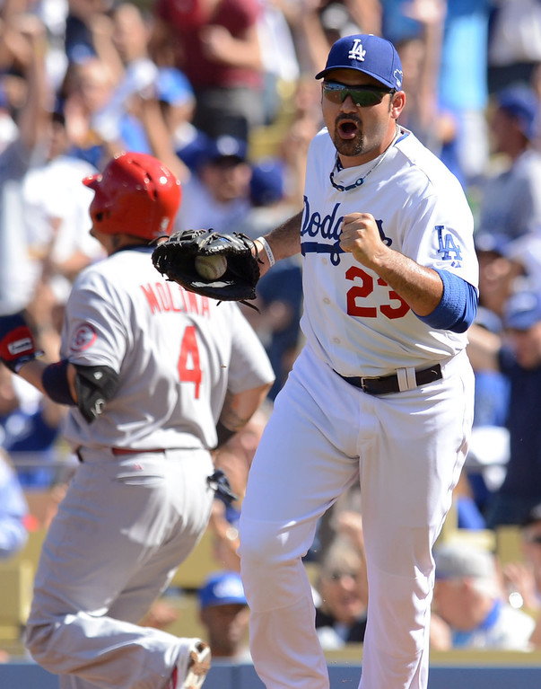 . The Dodgers\' Adrian Gonzalez reacts after completing a double play in the first inning against the Cardinals during game 5 of the NLCS at Dodger Stadium Wednesday, October 16, 2013.(David Crane/Los Angeles Daily News)