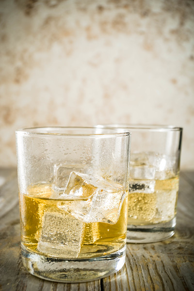 Amber Whiskey On The Rocks, Alcohol Drink In Short Glass, Wooden Background Copy Space