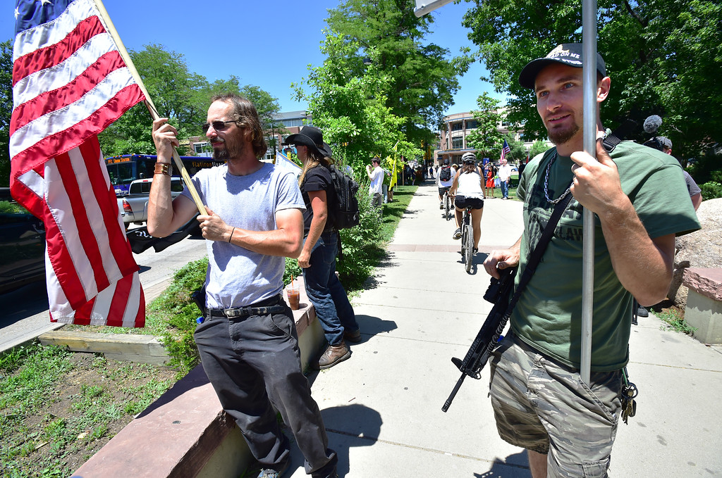 . Robert Studebaker, left and Bacca, who asked that his first name not be used, during a Second Amendment rally in Boulder on Saturday.  For more photos and video go to dailycamera.com. Paul Aiken Staff Photographer