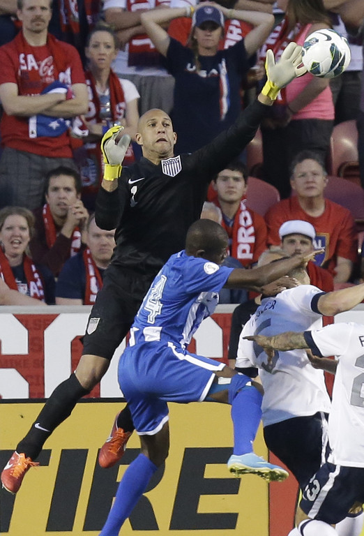 . United State\'s goalie Tim Howard makes a save over Honduras\' Oscar Boniek Garcia (14) in the second half during an World Cup qualifying soccer match at Rio Tinto Stadium on Tuesday, June 18, 2013, in Sandy, Utah.  (AP Photo/Rick Bowmer)