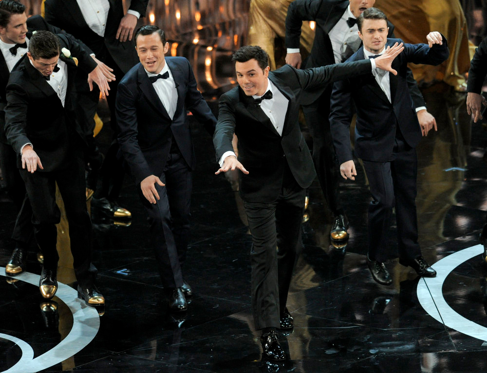 Description of . From second left, actors Joseph Gordon-Levitt, Seth MacFarlane and Daniel Radcliffe perform onstage during the Oscars at the Dolby Theatre on Sunday Feb. 24, 2013, in Los Angeles.  (Photo by Chris Pizzello/Invision/AP)