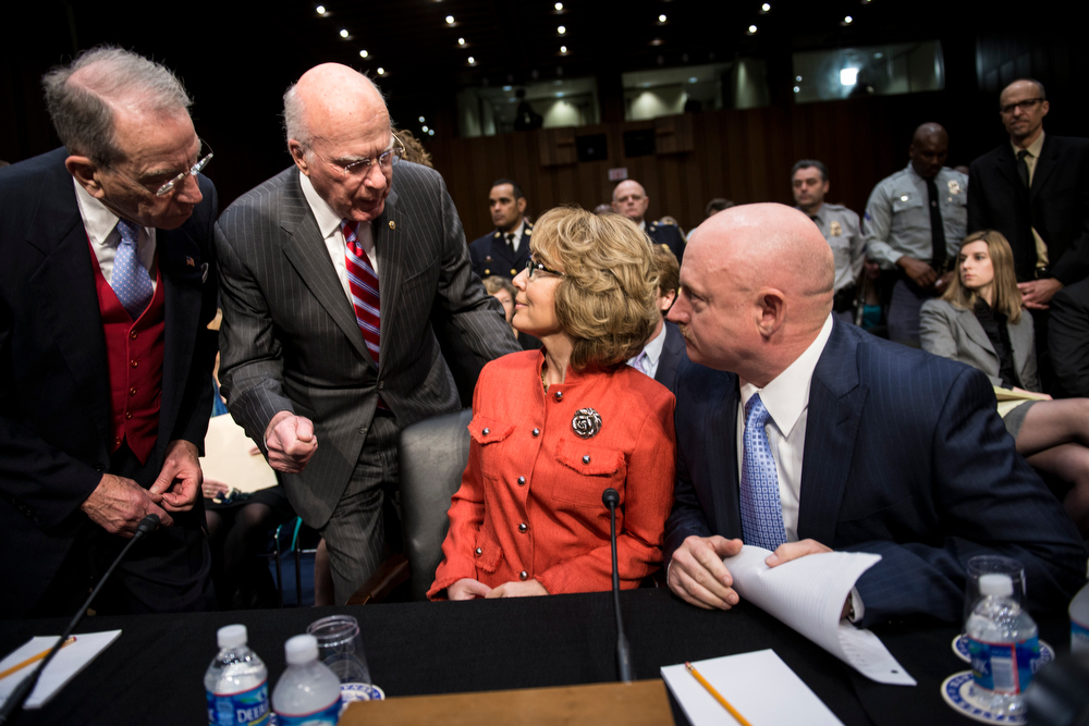 . Committee ranking member Senator Chuck Grassley(L) R-IA and chairman Senator Patrick Leahy (2ndL) D-VT as they talk to shooting victim former Rep. Gabrielle Giffords (2R) and her husband retired Astronaut Mark Kelly,  during a hearing of the Senate Judiciary Committee on Capitol Hill January 30, 2013 in Washington, DC. The committee held the hearing with  Mark Kelly, Wayne LaPierre, Chief Executive Officer of the National Rifle Association, and others to testify about solutions to gun violence in the United States.  BRENDAN SMIALOWSKI/AFP/Getty Images