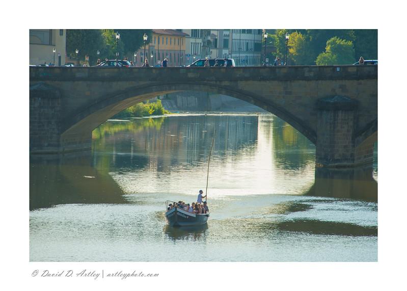 tour boat under Ponte S. Trinita, Florence, Italy