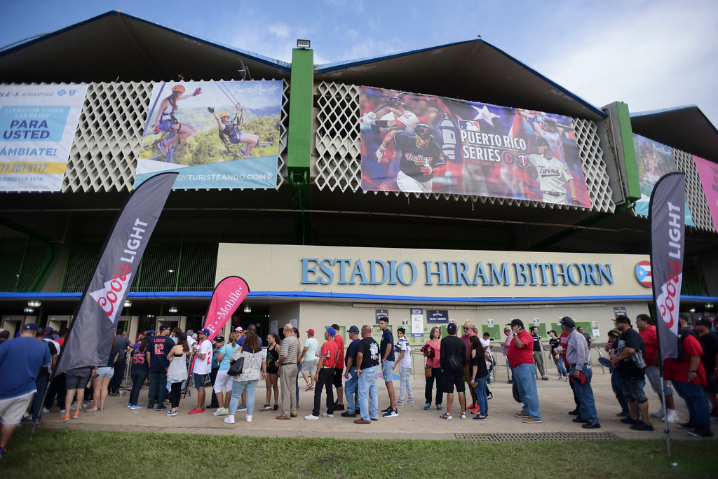 . People wait to enter Hiram Bithorn Stadium for the final game of a two-game Mayor League Series between the Minnesota Twins and the Cleveland Indians in San Juan, Puerto Rico, Wednesday, April 18, 2018. (AP Photo/Carlos Giusti)