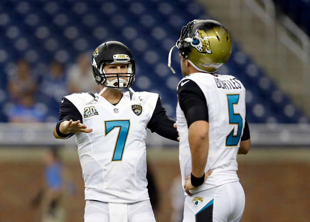 . Jacksonville Jaguars quarterback Chad Henne (7) talks with Blake Bortles (5) during warmups for a NFL football game against the Detroit Lions in Detroit, Friday, Aug. 22, 2014.  (AP Photo/Paul Sancya)