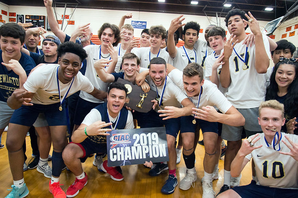06/06/19 Wesley Bunnell | Staff #1 Newington defeated #2 Cheshire in the boys volleyball Class M championship game at Shelton High School on Thursday night. Team members flash the number three for three championships in a row.