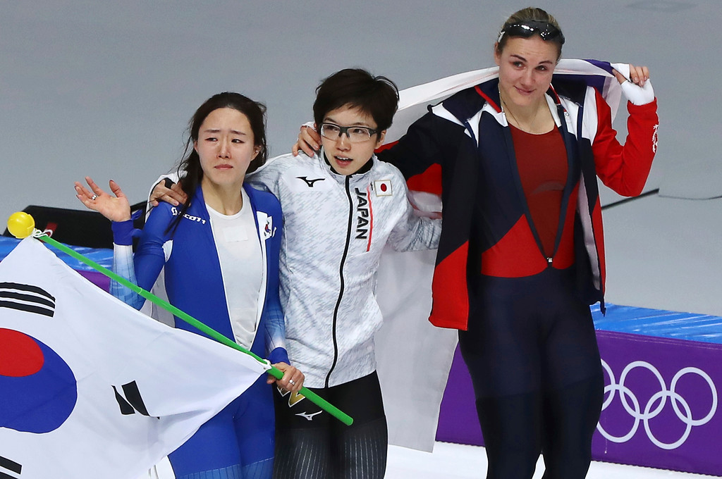 . Gold medalist Japan\'s Nao Kodaira, center, silver medalist Lee Sang-hwa of South Korea, left and crying, and bronze medalist Karolina Erbanova of the Czech Republic skate together after the women\'s 500 meters speedskating race at the Gangneung Oval at the 2018 Winter Olympics in Gangneung, South Korea, Sunday, Feb. 18, 2018. (AP Photo/Eugene Hoshiko)