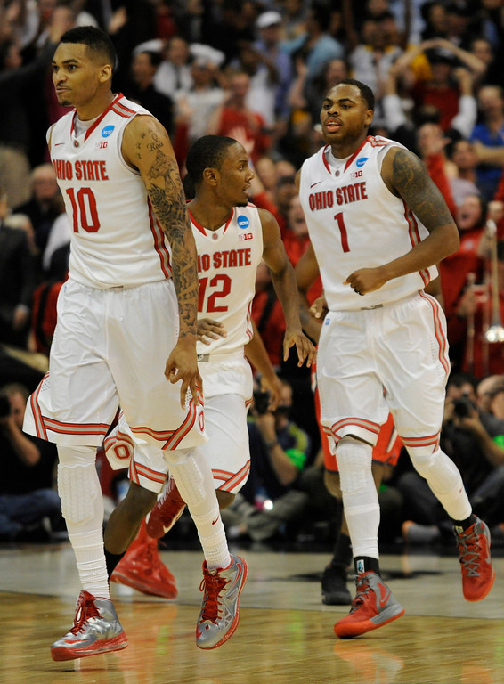. Ohio State #10 LaQuinton Ross is followed up the floor by #12 Sam Thompson and #1 Deshaun Thomas after Ross made a 3 point basket with 2.1 seconds left in the game. Ohio State defeated Arizona 73-70 at Staples Center for the West Regional of the NCAA Division I Men\'s Basketball Championships. Los Angeles,CA 3/28/2013(John McCoy/Staff Photographer