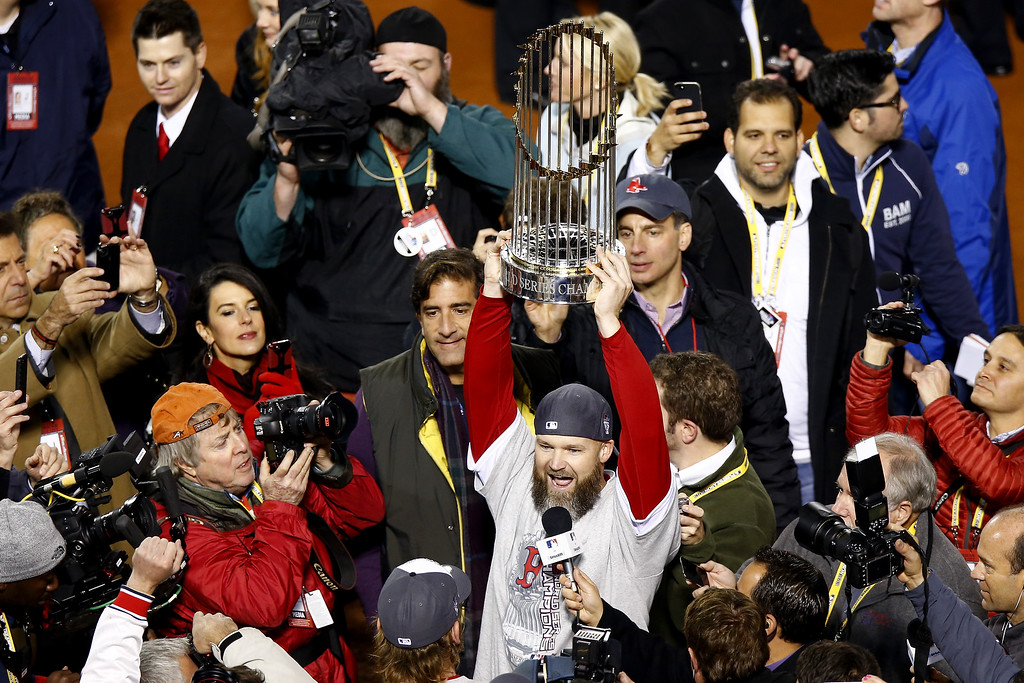 . David Ross #3 of the Boston Red Sox holds up the World Series trophy after defeating the St. Louis Cardinals 6-1 in Game Six of the 2013 World Series at Fenway Park on October 30, 2013 in Boston, Massachusetts.  (Photo by Jared Wickerham/Getty Images)