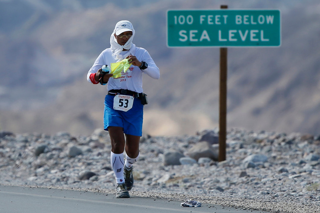 . Ben Gaetos of the Philippines, 56, competes during the Badwater Ultramarathon in Death Valley National Park, California July 15, 2013. The 135-mile (217 km) race, which bills itself as the world\'s toughest foot race, goes from Death Valley to Mt. Whitney, California in temperatures which can reach 130 degrees Fahrenheit (55 Celsius).  REUTERS/Lucy Nicholson