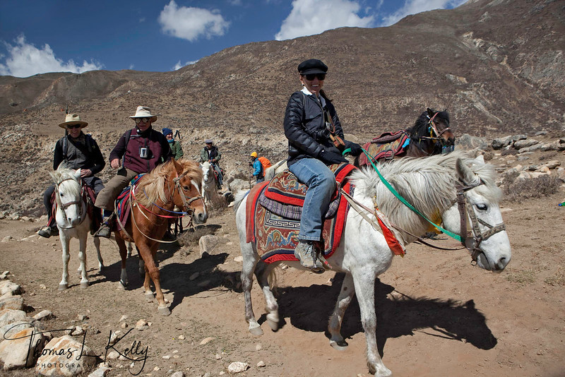 Mounting steeds for the ascent up the Marang (Chogo) la pass (4230m) and travel to the now abandoned hermitage ruins of Samdrupling. Mustang, Nepal.