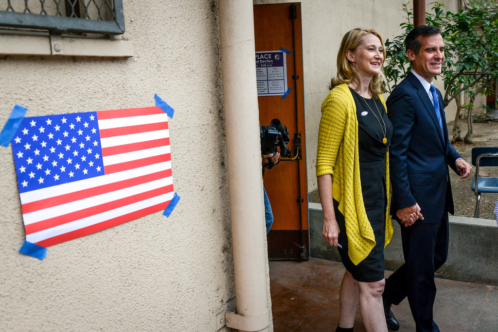 . Mayoral candidate Eric Garcetti and his wife Amy exit the polling place at Allesandro Elementary school in Los Angeles early Tuesday morning.  Los Angeles residents will vote for a new mayor, Garcetti or Wendy Gruel in the citywide election.  Photo by David Crane/Staff Photographer