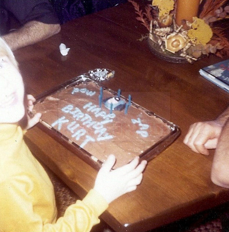 . This undated photo provided by Kim Cobain a young Kurt Cobain celebrates a birthday at his childhood home in Aberdeen, Wash.   (AP Photo/Courtesy Kim Cobain)