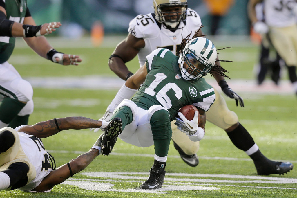 . New York Jets wide receiver Josh Cribbs (16) is tackled by New Orleans Saints\' Corey White (24) as Keyunta Dawson (55) closes in during the second half of an NFL football game Sunday, Nov. 3, 2013, in East Rutherford, N.J.  (AP Photo/Mel Evans)
