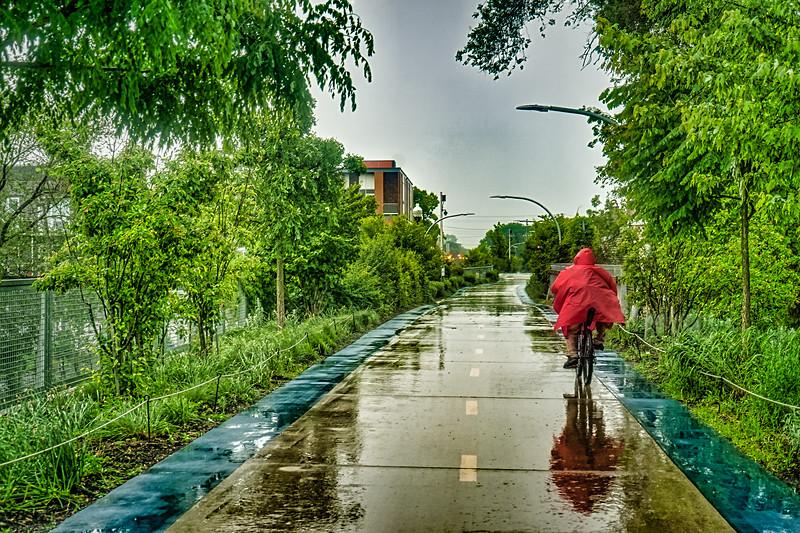 red raincoat on a bike.jpg