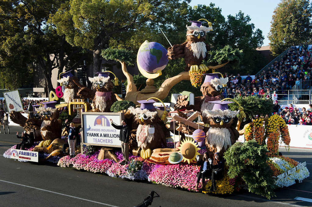 ". Farmer\'s Insurance ""Thanks a Million Teachers\"" float during 2014 Rose Parade in Pasadena, Calif. on January 1, 2014. (Staff photo by Leo Jarzomb/ Pasadena Star-News)"