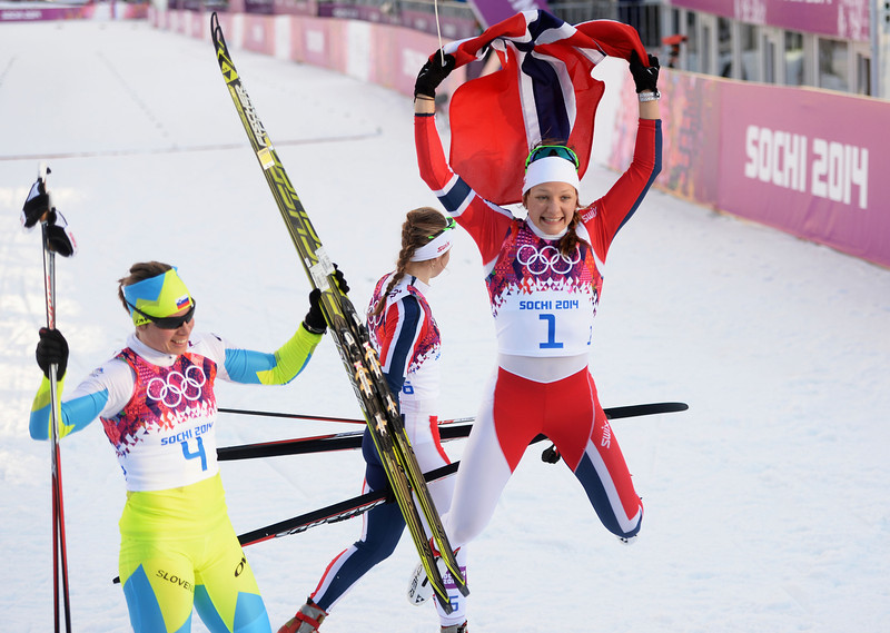 . Maiken Caspersen Falla of Norway (R) and Vesna Fabjan of Slovenia celebrate after winning first and third place in the Finals of the Ladies\' Sprint Free during day four of the Sochi 2014 Winter Olympics at Laura Cross-country Ski & Biathlon Center on February 11, 2014 in Sochi, Russia.  (Photo by Harry How/Getty Images)