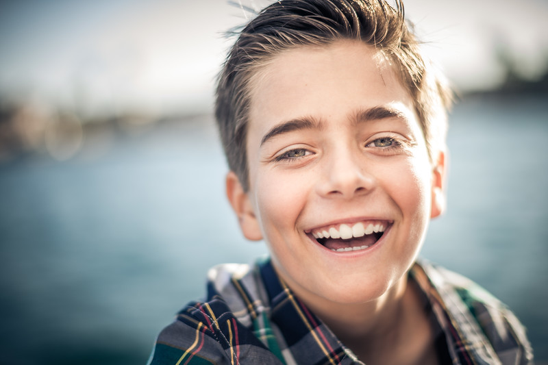 Portrait of a Young Caucasian boy laughing.