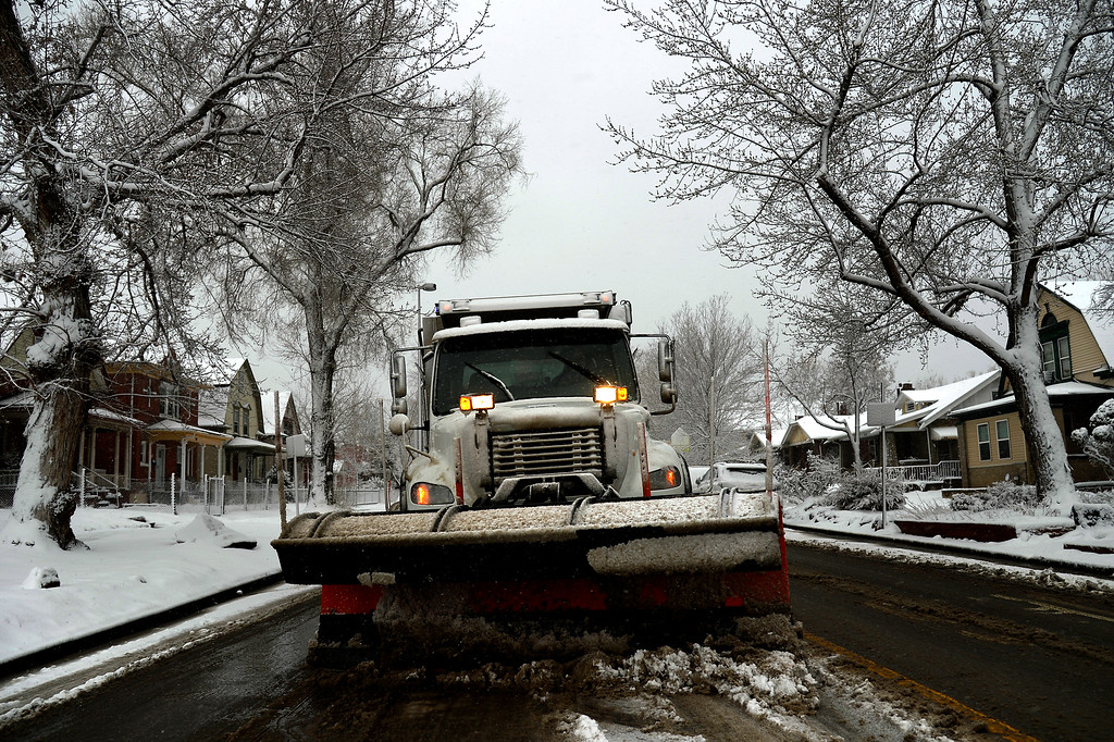 . DENVER, CO. - February 25, 2015: Snow plow waiting in dead stop traffic on Downing St. in downtown Denver.  February 25, 2015 Denver, CO (Photo By Joe Amon/The Denver Post)