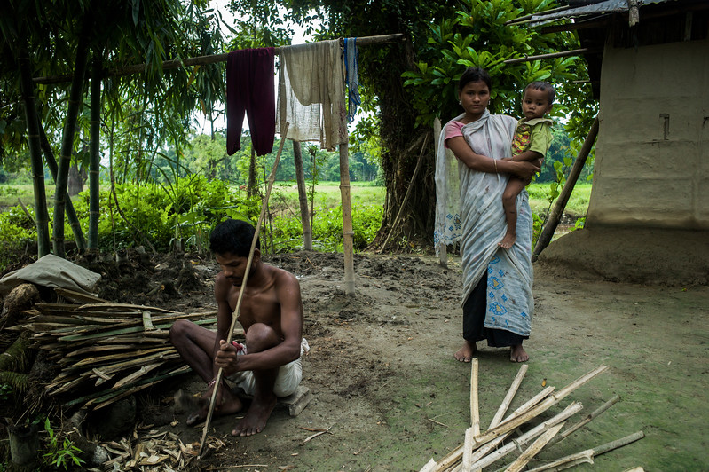 Dhemanji, Assam, India August,2014:   Debo Jani(16) married when she was 12 seen with her husband Chitra Das (18) and the youngest child infront of their home in Guyekhanna village near Dhemanji town.   Series on early marriages in Assam, India for Al Jazeera America.       Photo:  Sami Siva