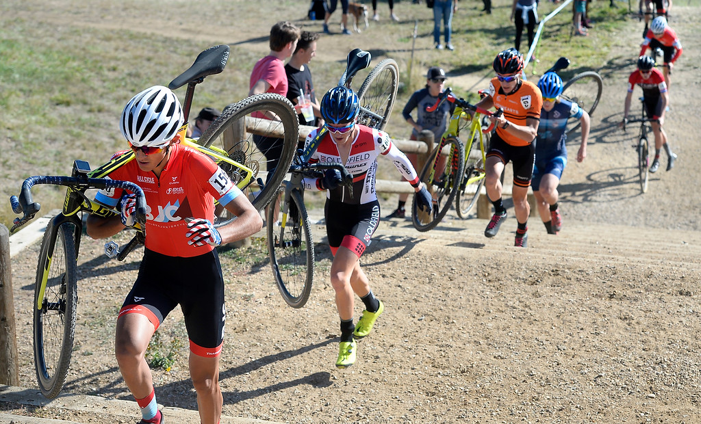 . BOULDER, CO - October 13, 2018: Jared Scott, left,  leads the  pack up the stairs during the first lap of the Alfalfa�s Eldora US Open cyclocross championship men\'s junior race at Valmont Bike Park in Boulder.  (Photo by Cliff Grassmick/Staff Photographer)