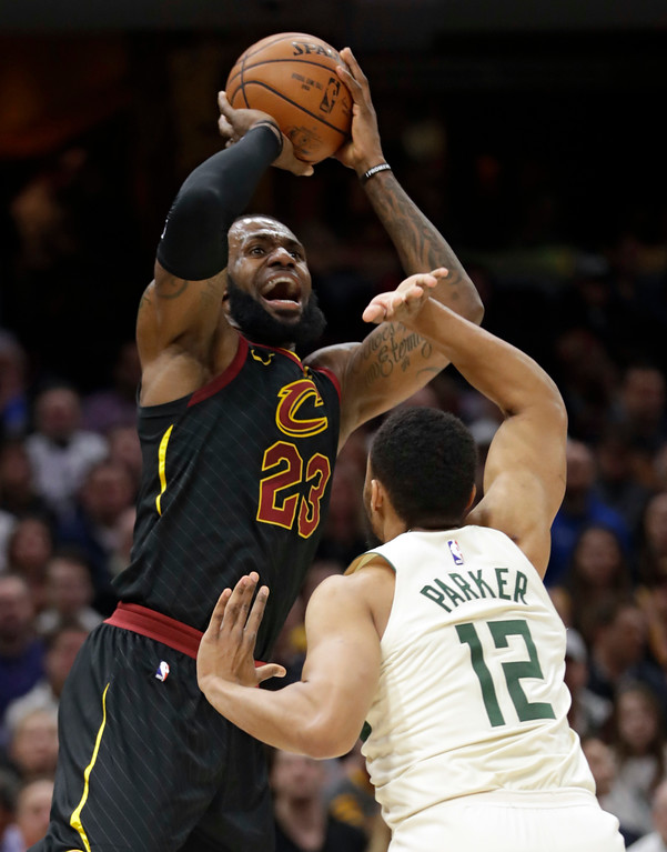 . Cleveland Cavaliers\' LeBron James (23) shoots against Milwaukee Bucks\' Jabari Parker (12) in the first half of an NBA basketball game, Monday, March 19, 2018, in Cleveland. (AP Photo/Tony Dejak)