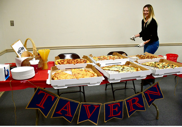 3/14/2019 Mike Orazzi | Staff First and Last Tavern's Christina Pascale while enjoying some pizza during the Plainville Chamber of Commerce 2019 Pizza Feud at the Veterans of Foreign Wars in Plainville Thursday evening.