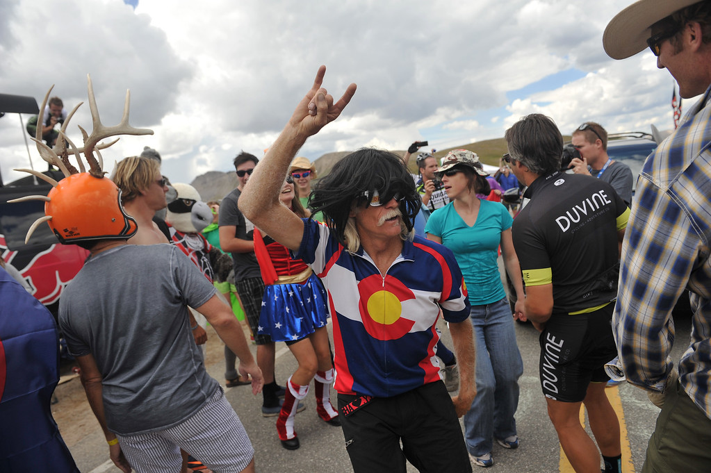 . Fans entertain themselves at the  top of Independence Pass after the riders passed by. (Photo By Hyoung Chang/The Denver Post)