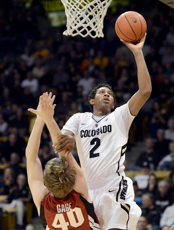 . University of Colorado\'s Xavier Johnson takes a shot over John Gage, No. 40, during a game against Stanford on Thursday, Jan. 24, at the Coors Event Center on the CU campus in Boulder. Jeremy Papasso/ Camera