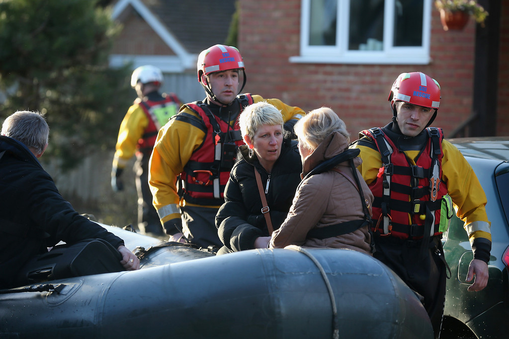 . Residents are evacuated from their homes which are cut off by flood water on February 11, 2014 in Chertsey, United Kingdom. The Environment Agency contiues to issue severe flood warnings for a number of areas on the river Thames in the commuter belt west of London. With heavier rains forecast for the coming week people are preparing for for the water levels to rise.  (Photo by Christopher Furlong/Getty Images)