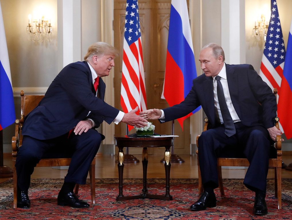. U.S. President Donald Trump, left, and Russian President Vladimir Putin shake hand at the beginning of a meeting at the Presidential Palace in Helsinki, Finland, Monday, July 16, 2018. (AP Photo/Pablo Martinez Monsivais)