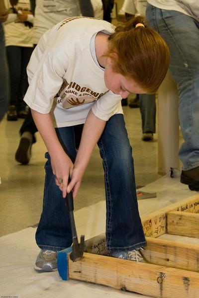 "1) Slug #: W 00017811; (2) Ridgewood, NJ; (3) 10/25/08; (4) Ridgewood ""Make A Difference Day"" Habitat for Humanity build; (5) Erin Walicki pitches in at Make A Difference Day, joining Paterson's Habitat for Humanity at the Ridgewood Community Center on 10/25/2008; (6) W.H. GRAE for the Ridgewood News."