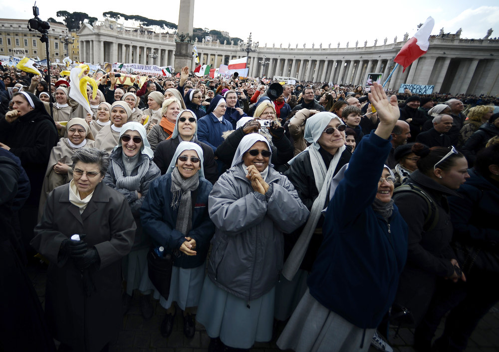 . Nuns wave during Pope Benedict XVI last Angelus Prayer on St. Peter\'s Square at the Vatican on February 24, 2013. Pope Benedict XVI on Sunday told tens of thousands of pilgrims in St Peter\'s Square in a voice breaking with emotion that he was resigning because God had called on him to devote himself to prayer but said he would not abandon the Church.  FILIPPO MONTEFORTE/AFP/Getty Images