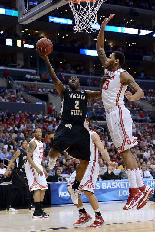 . LOS ANGELES, CA - MARCH 30:  Malcolm Armstead #2 of the Wichita State Shockers goes up for a shot against Amir Williams #23 of the Ohio State Buckeyes in the first half during the West Regional Final of the 2013 NCAA Men\'s Basketball Tournament at Staples Center on March 30, 2013 in Los Angeles, California.  (Photo by Harry How/Getty Images)