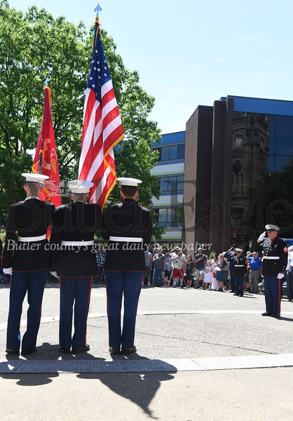 Harold Aughton/Butler Eagle: Members of the Bantam Marine Corps Detachment #743 present the colors during a special ceremony commemorating those who died in battle following the parade in Diamond Park.
