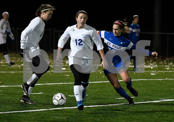 11/14/2017 Mike Orazzi | Staff Old Lyme's Mya Johnson (12) and St. Paul's Briana Senese (38) during the Class S Semifinals Girls Soccer at Falcon Field in Meriden Tuesday night.