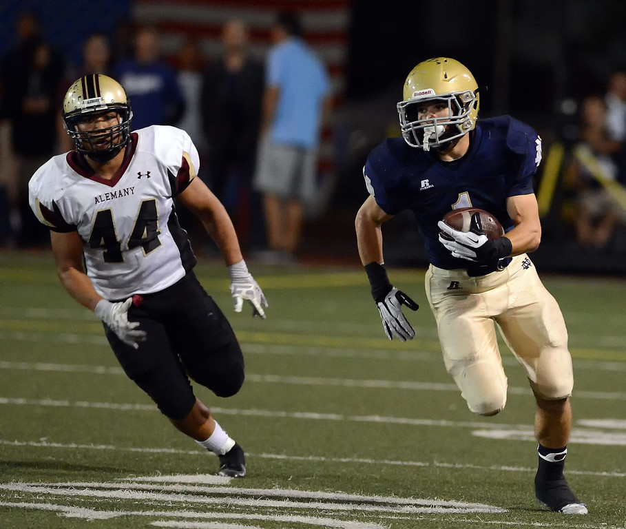 . Notre Dame\'s Chris Colarossi #1 heads up field as Alemany\'s Okalani Langi #44 pursues during their football game at Notre Dame High School Friday, October 18, 2013.  (Photo by Hans Gutknecht/Los Angeles Daily News)