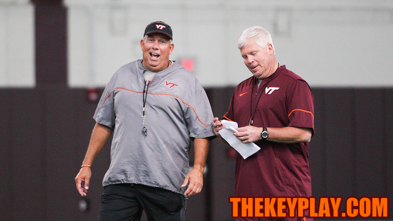 Coaches Charley Wiles and James Shibest speak with each other before the start of fall practice. (Mark Umansky/TheKeyPlay.com)