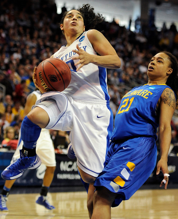 . Kentucky\'s Jennifer O\'Neill, left, drives to the basket againsty Delaware\'s Trumae Lucas, right, during the second half of a regional semifinal in the NCAA college basketball tournament in Bridgeport, Conn., Saturday, March 30, 2013. O\'Neill scored 19 points as Kentucky won 69-62. (AP Photo/Jessica Hill)