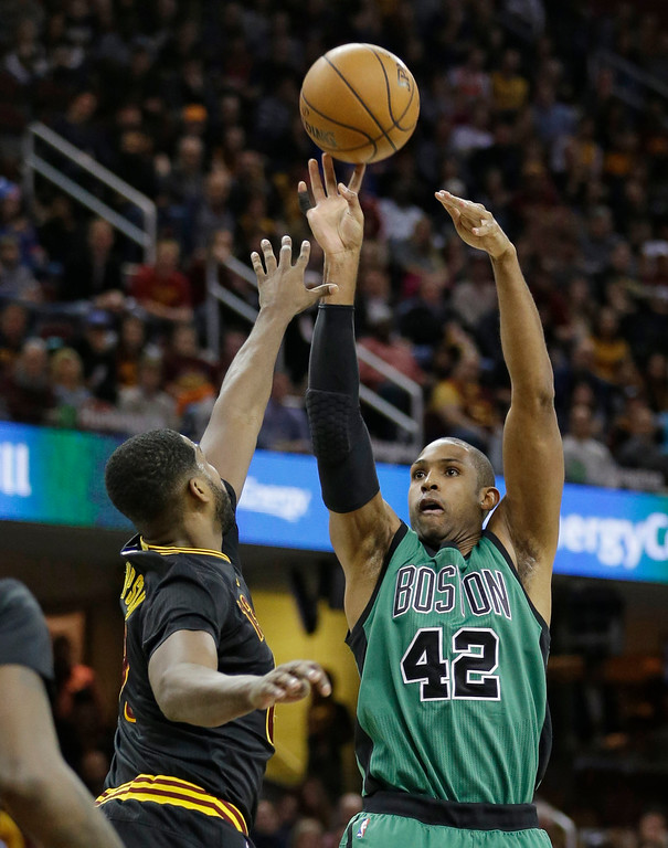 . Boston Celtics\' Al Horford (42), from the Dominican Republic, shoots over Cleveland Cavaliers\' Tristan Thompson in the first half of an NBA basketball game, Thursday, Dec. 29, 2016, in Cleveland. (AP Photo/Tony Dejak)