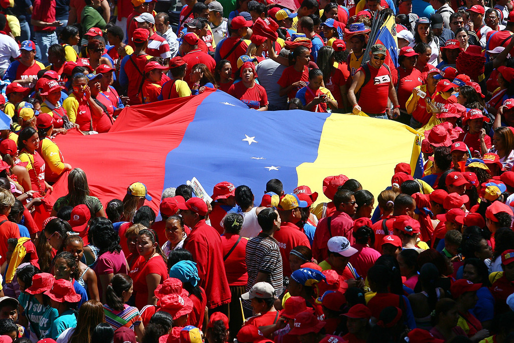 """. Supporters of Venezuelan President Hugo Chavez rally in Caracas on February 27, 2013, to commemorate the 24th anniversary of the Patriotic Rebellion. The \""""Caracazo\"""" of 1989 was a wave of protests against the neoliberal reforms imposed by the government of President Carlos Andres Perez, during which some 3000 people were killed. GERALDO CASO/AFP/Getty Images"""