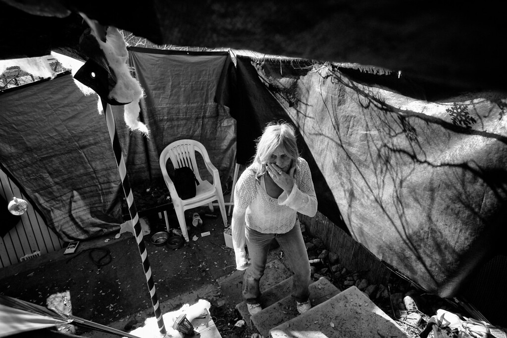 . Dorothy climbs the few steps she built up to her tent.  On this visit her compound was in disarray.
