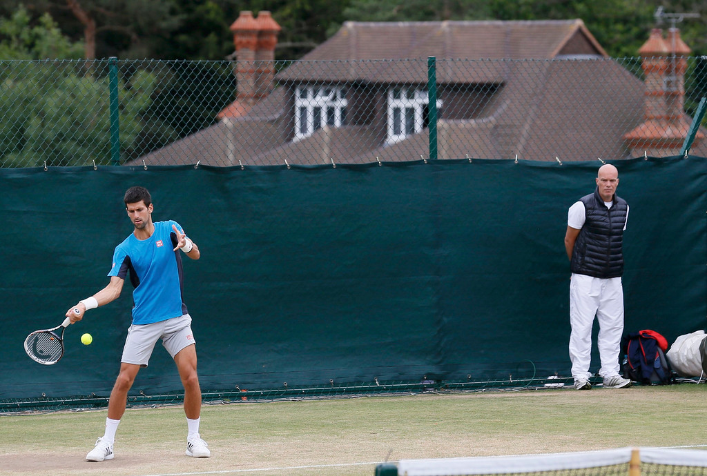 . Novak Djokovic of Serbia trains on a practise court at the Wimbledon Tennis Championships, in London July 4, 2013.      REUTERS/Stefan Wermuth