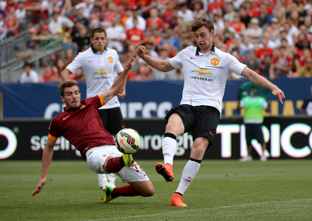 . Will Keane of Manchester United (48), right, and Mihai Balasa of AS Roma (72) are fighting for the control of the ball during Guinness International Champions Cup 2014 at Sports Authority Field at Mile High in Denver, Colorado,  July 26, 2014. (Photo by Hyoung Chang/The Denver Post)