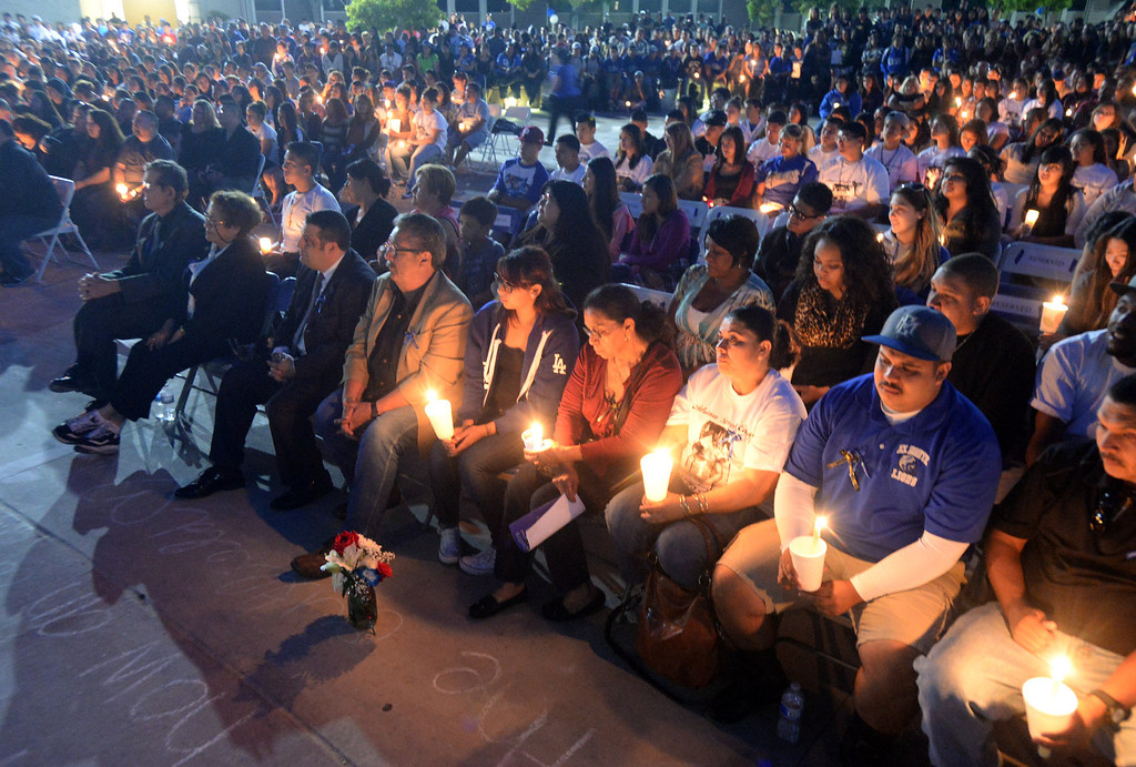 . Family, students and members of the community gather in memory of Adrian Castro, 19, at El Monte High School Monday evening April 14, 2014. Castro was one of nine students killed in the bus crash in Orland, Calif. (Staff Photo by Keith Durflinger/San Gabriel Valley Tribune)