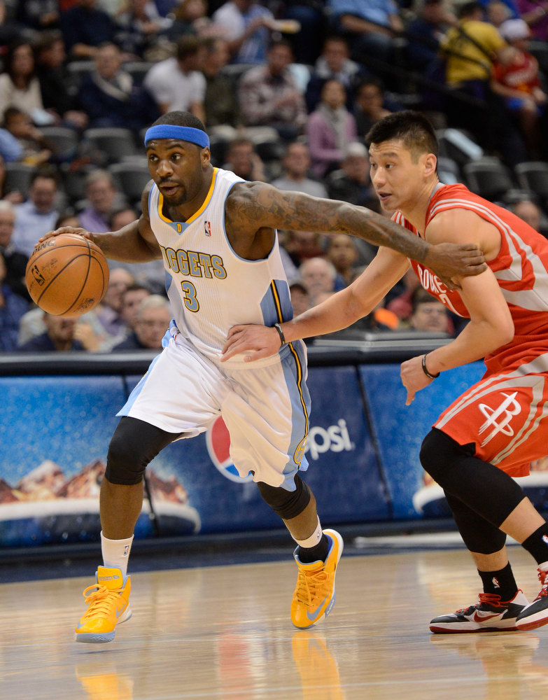. DENVER, CO. - JANUARY 30: Denver Nuggets point guard Ty Lawson (3) drives on Houston Rockets shooting guard James Harden (13) during the first quarter January 30, 2013 at Pepsi Center. The Denver Nuggets take on the Houston Rockets in NBA action. (Photo By John Leyba/The Denver Post)
