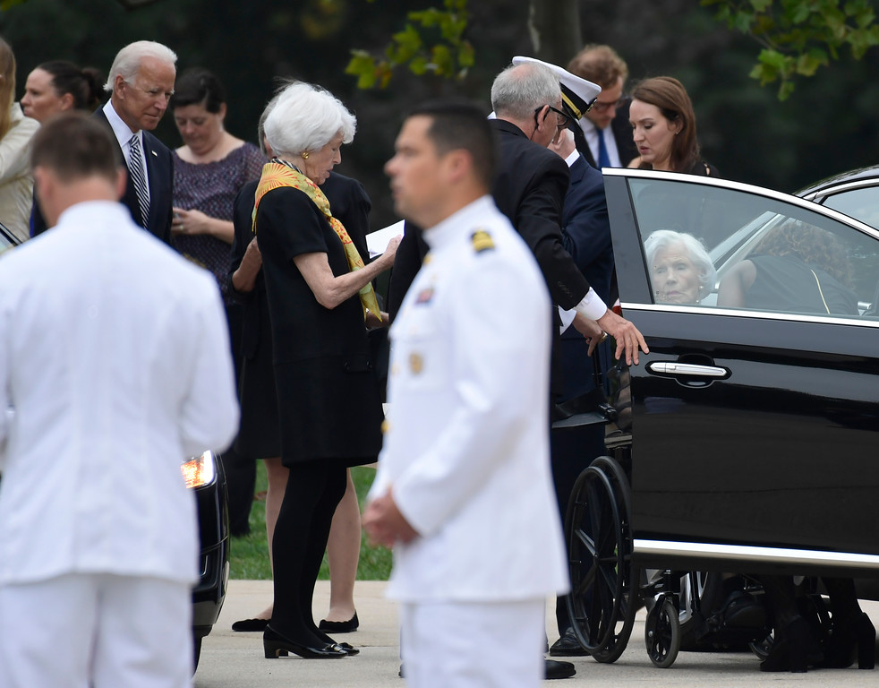 . Roberta McCain, right, mother of the late Sen. John McCain, R-Ariz., arrives at the Washington National Cathedral in Washington, Saturday, Sept. 1, 2018, for a memorial service for her son. Former Vice President Joe Biden watches at left. McCain died Aug. 25 from brain cancer at age 81. (AP Photo/Susan Walsh)